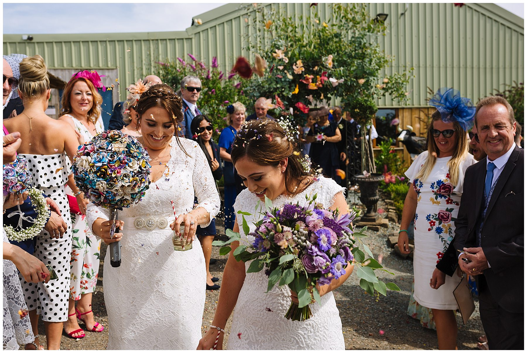 Two brides showered with confetti