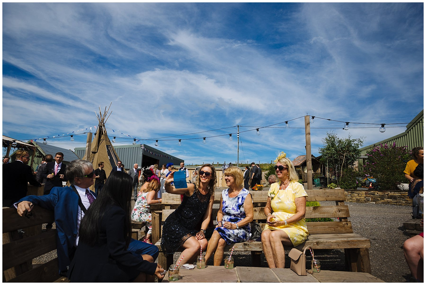 wedding guests enjoy the summer sun at the wellbeing farm