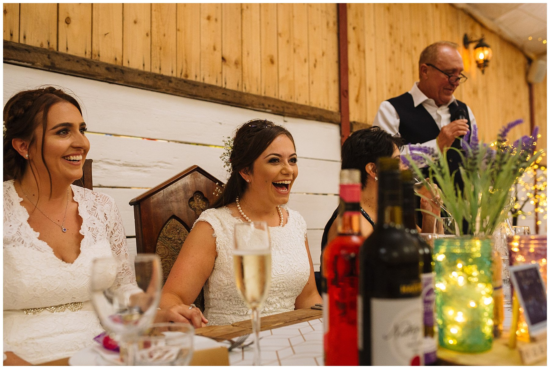 brides laugh reacting to fathers speech