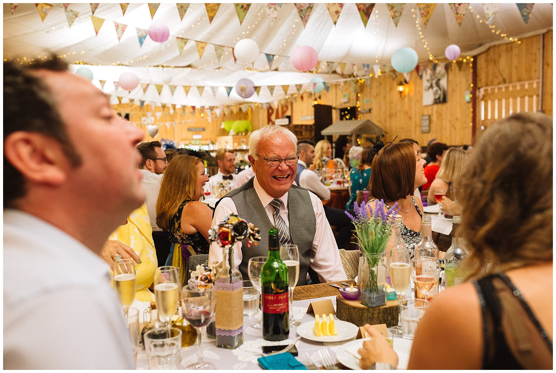 wedding guests laugh and react to speeches