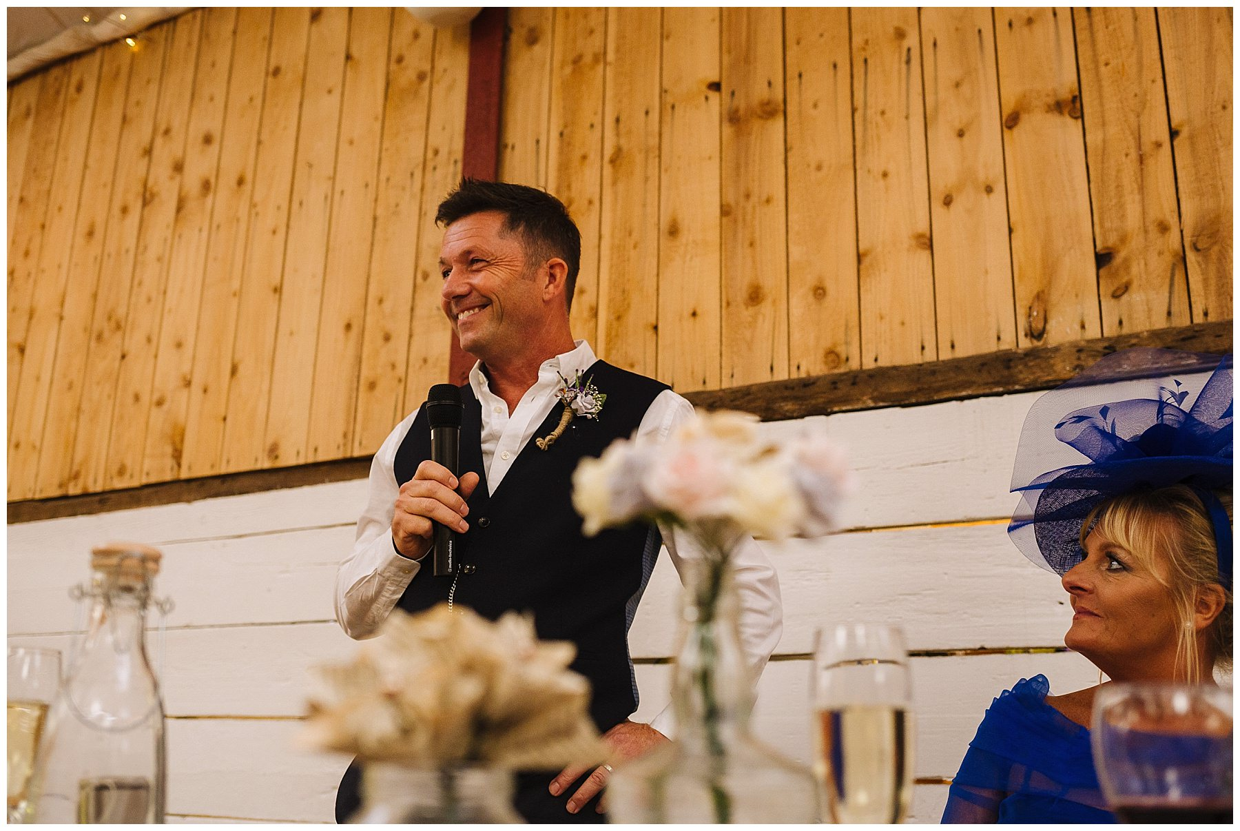 Father of the bride stands proud to speak at daughters wedding