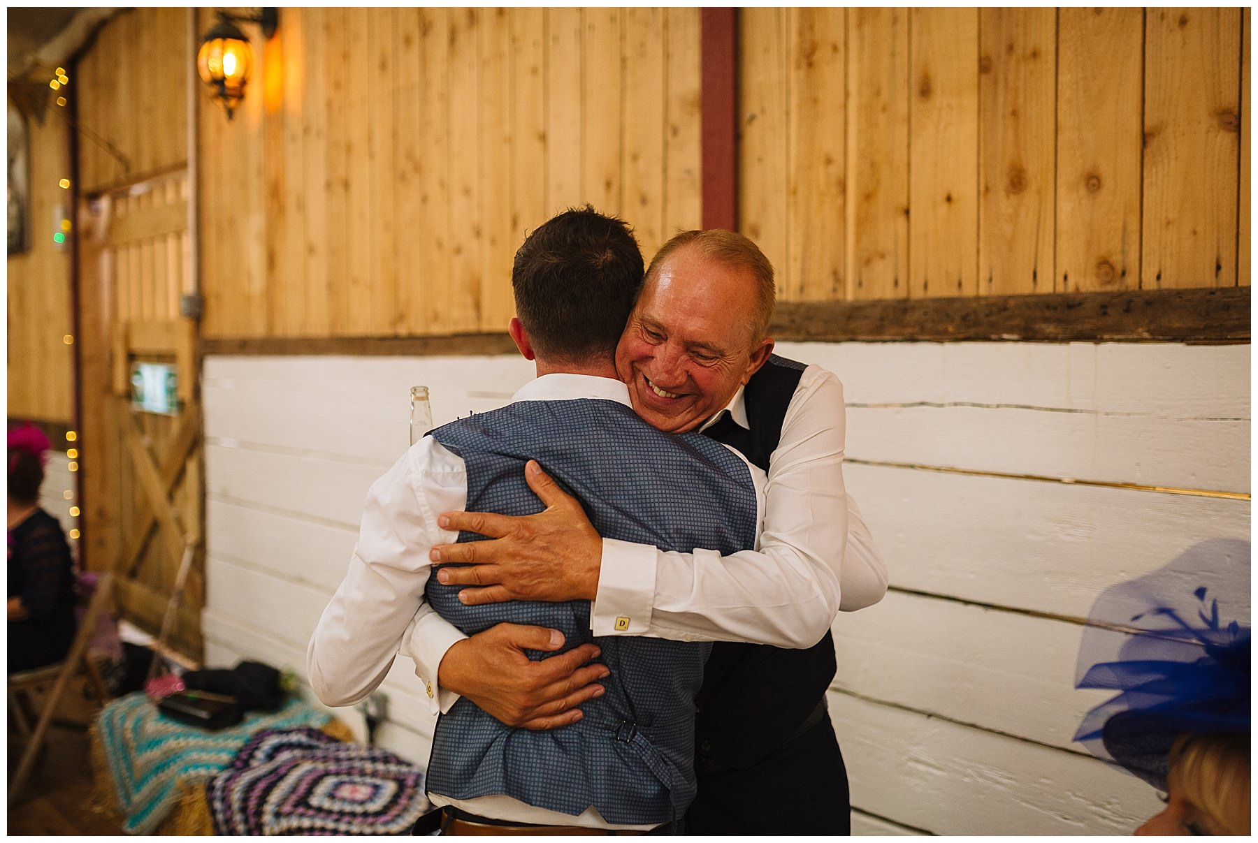 Two dads hug after speeches