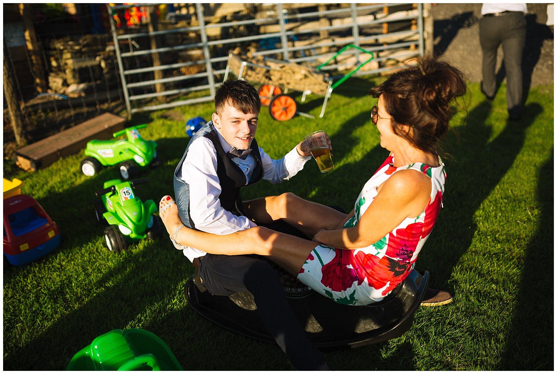 Wedding guests enjoy the lawn games at wellbeing farm wedding