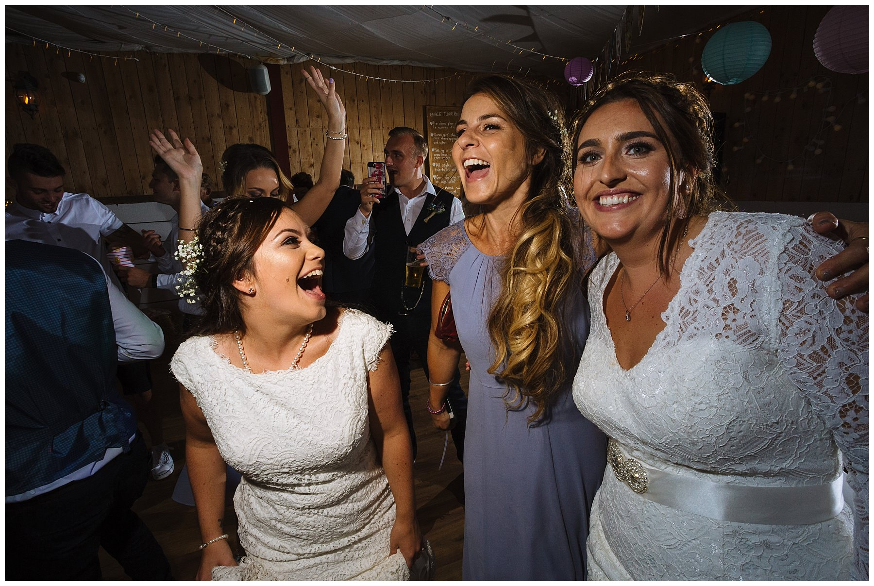 brides and maid of honour on the dancefloor