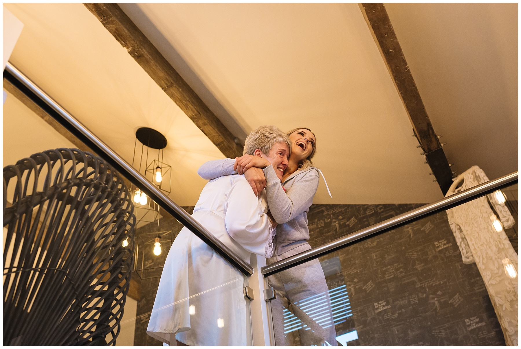 Bride and daughter share a moment during bridal prep