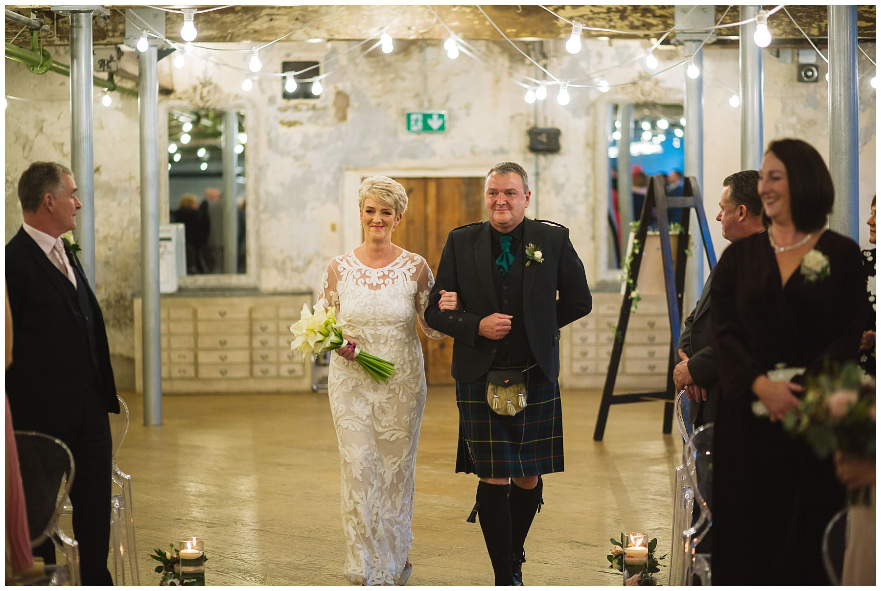 Bride walked down the isle by her brother who wears family tartan