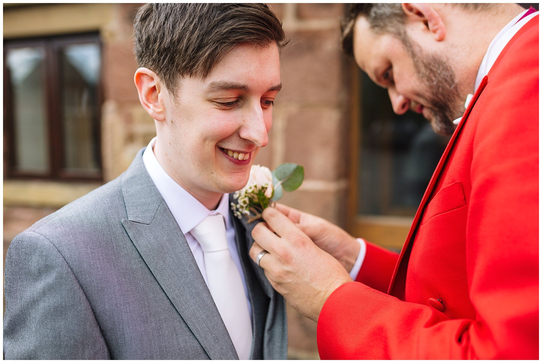 Toastmaster assists with grooms buttonhole