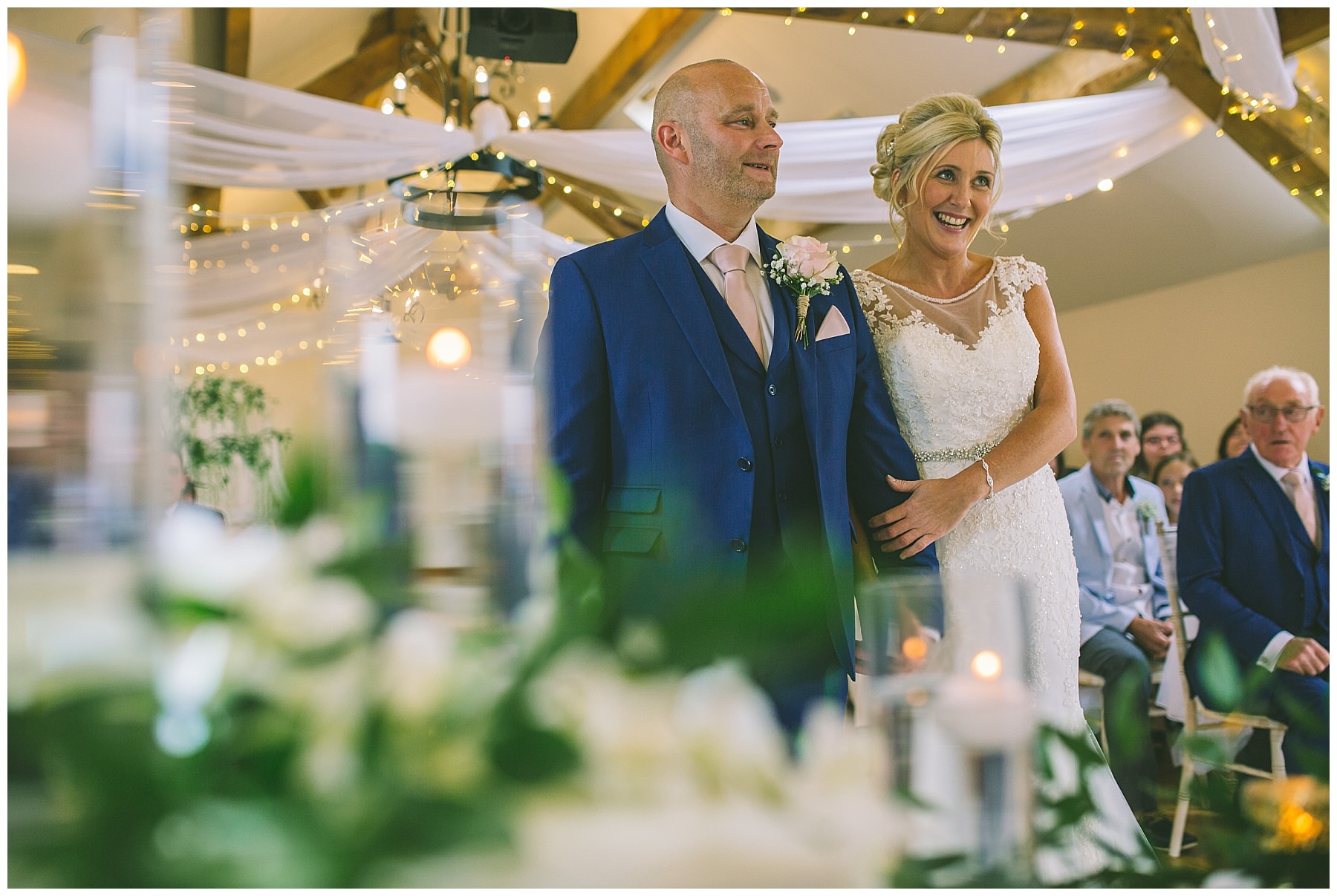 bride and groom in ceremony room at beeston manor