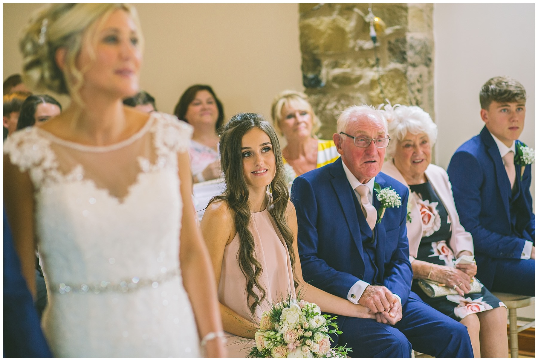 father of the bride holds grand daughters had during emotional wedding ceremony