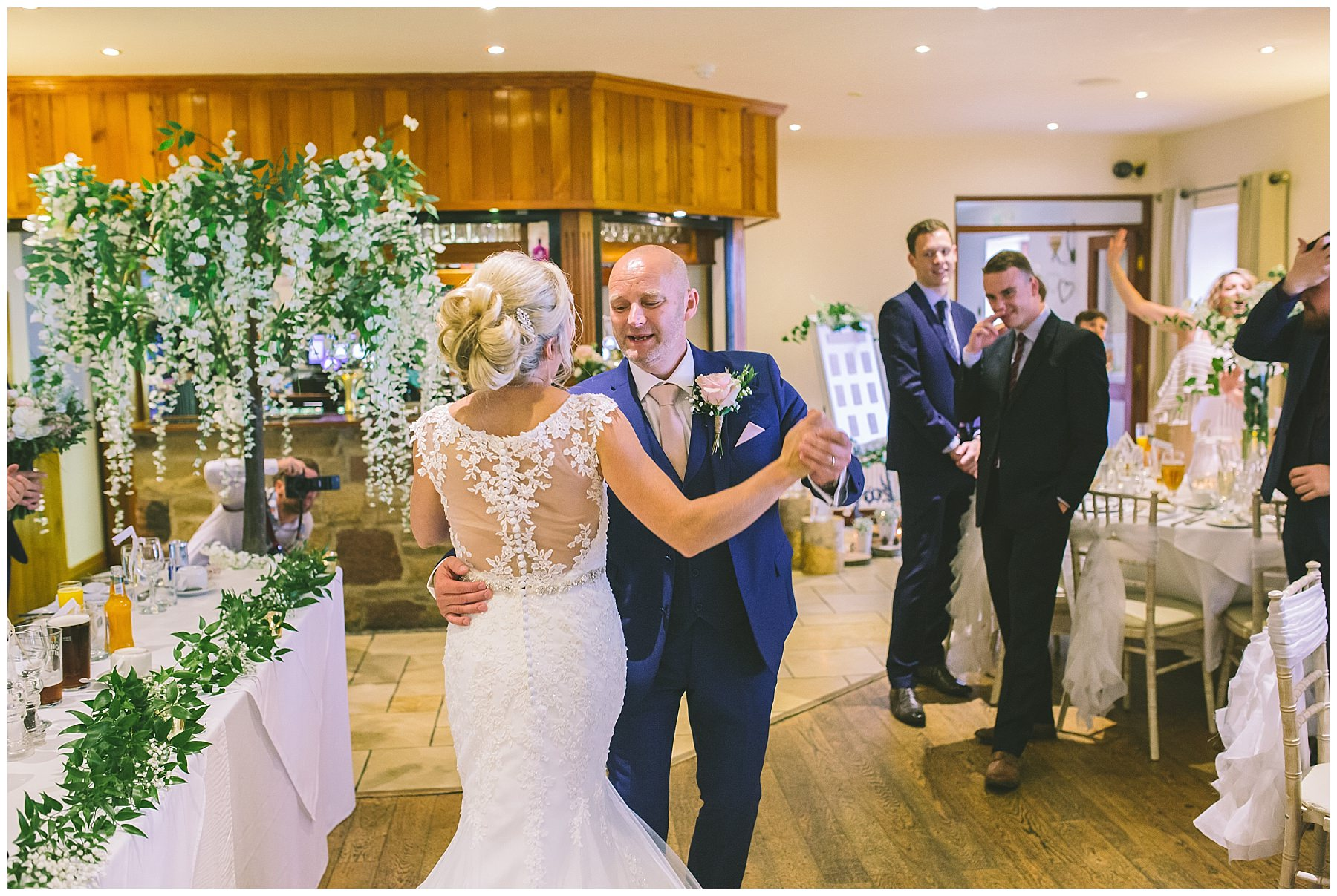 bride and groom do impromptu first dance during wedding breakfast entrance