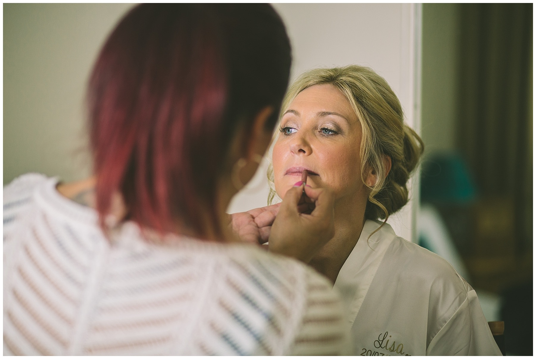 make up artist applies brides lip liner at beeston manor