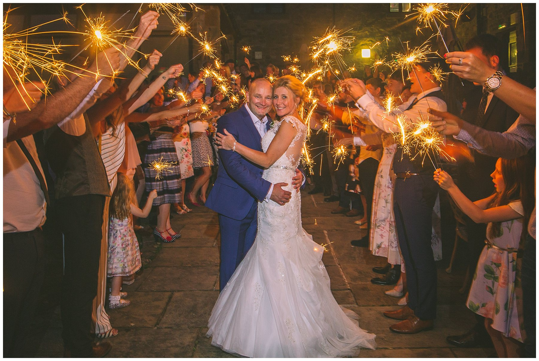 bride and groom perform sparkler exit at beeston manor