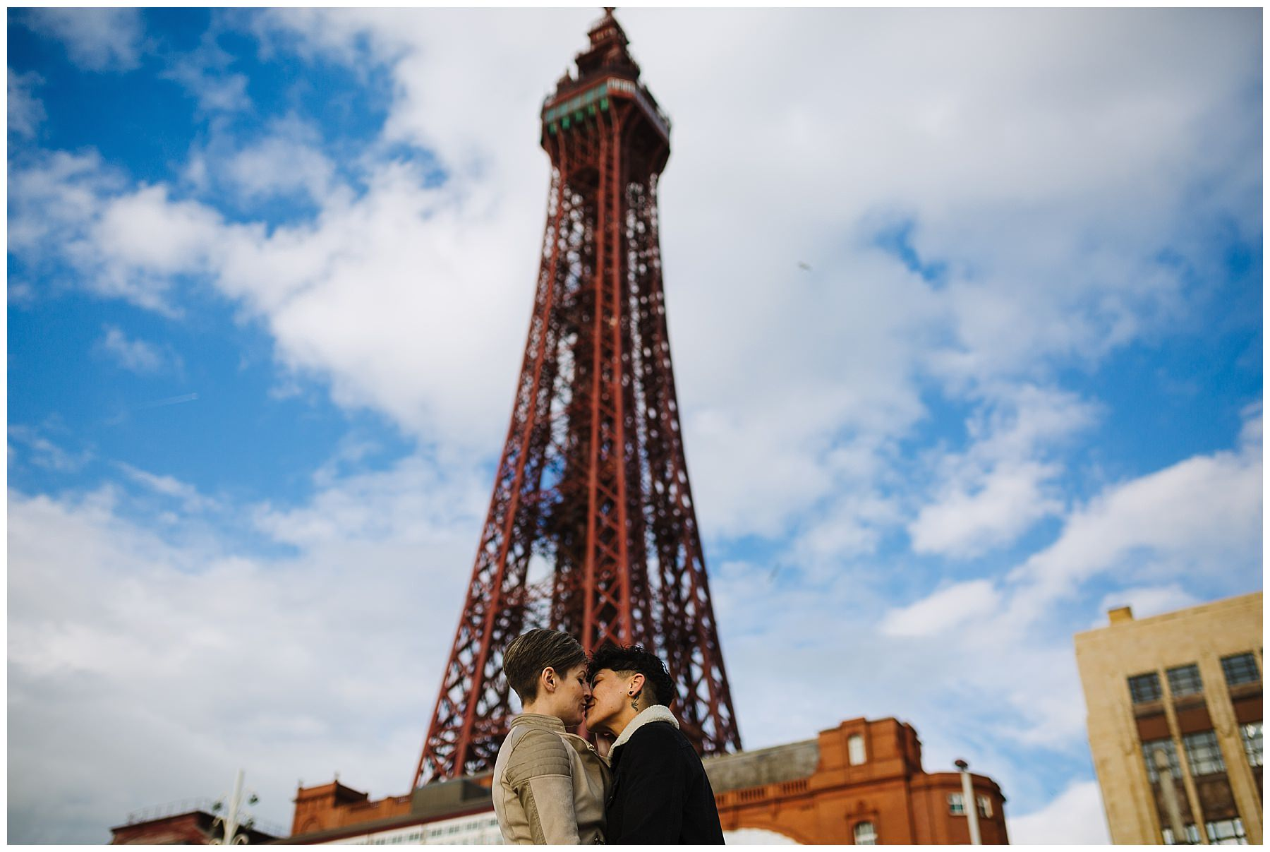 Couple kiss in front of Blackpool Tower