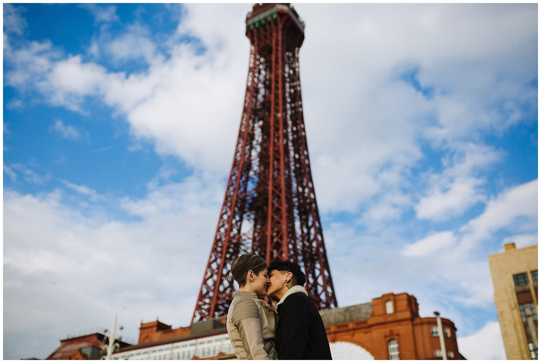 Same sex couple in front of Blackpool tower