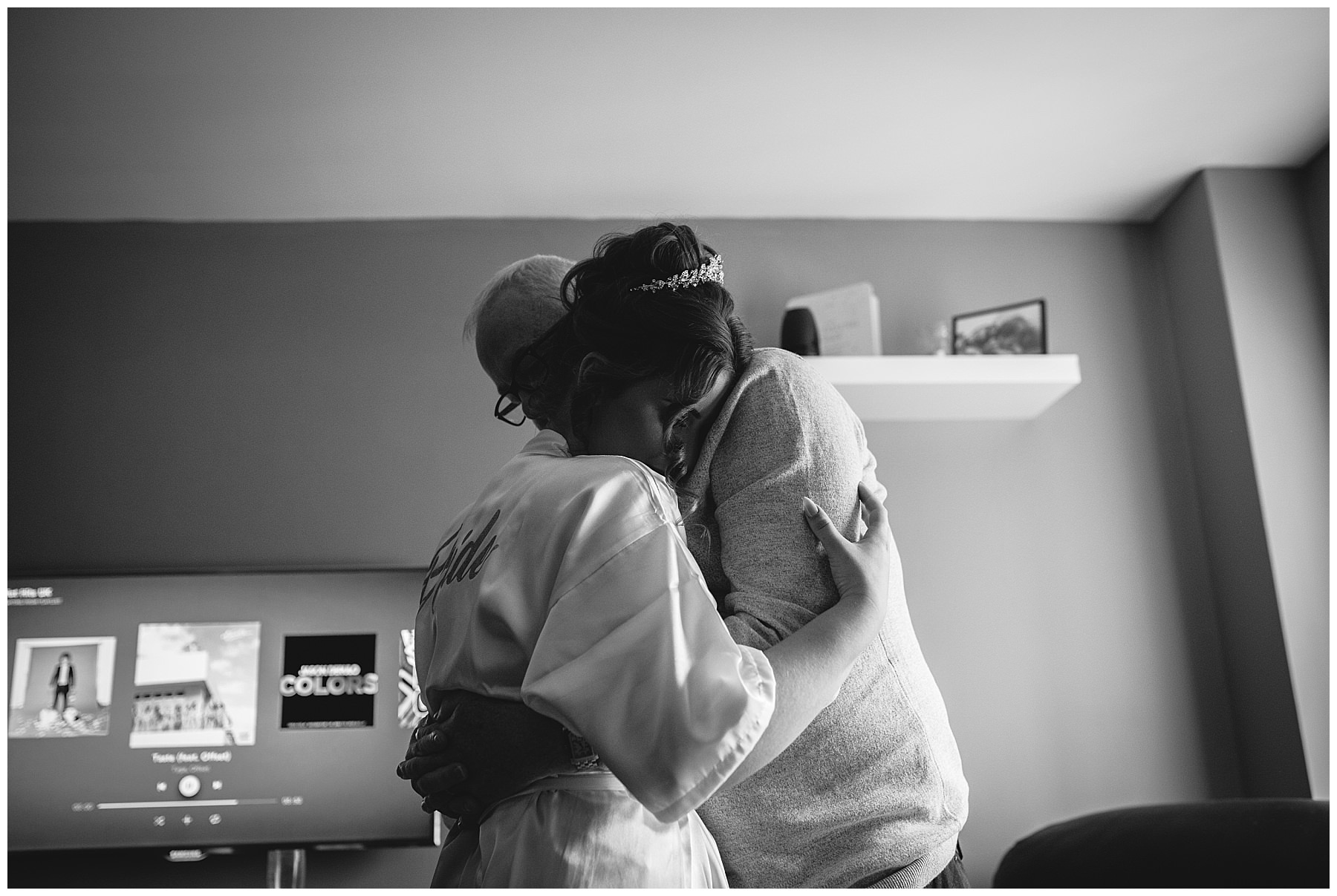 bride and father share a hug on the morning of her wedding