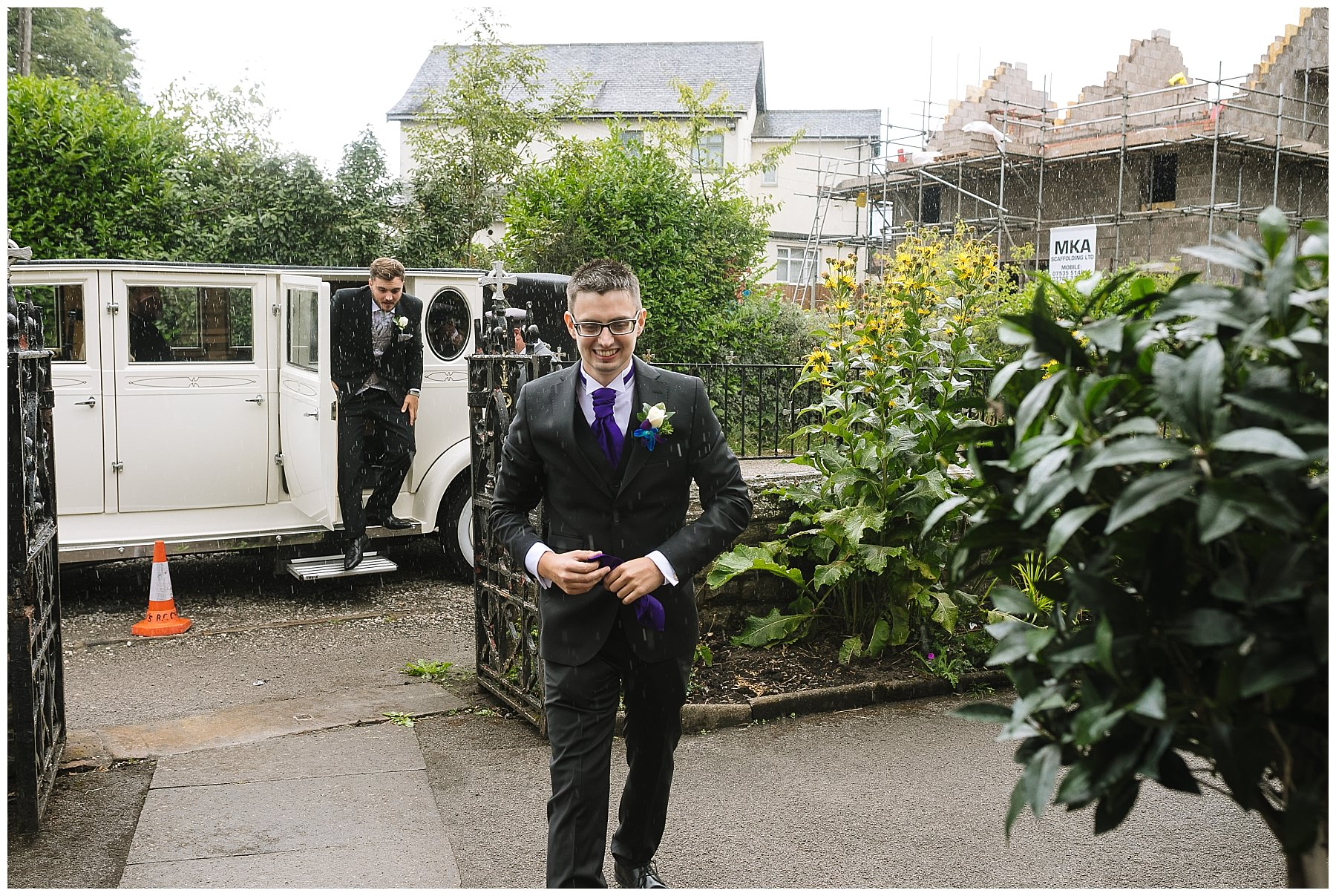 groom arrives at wigan church in the rain