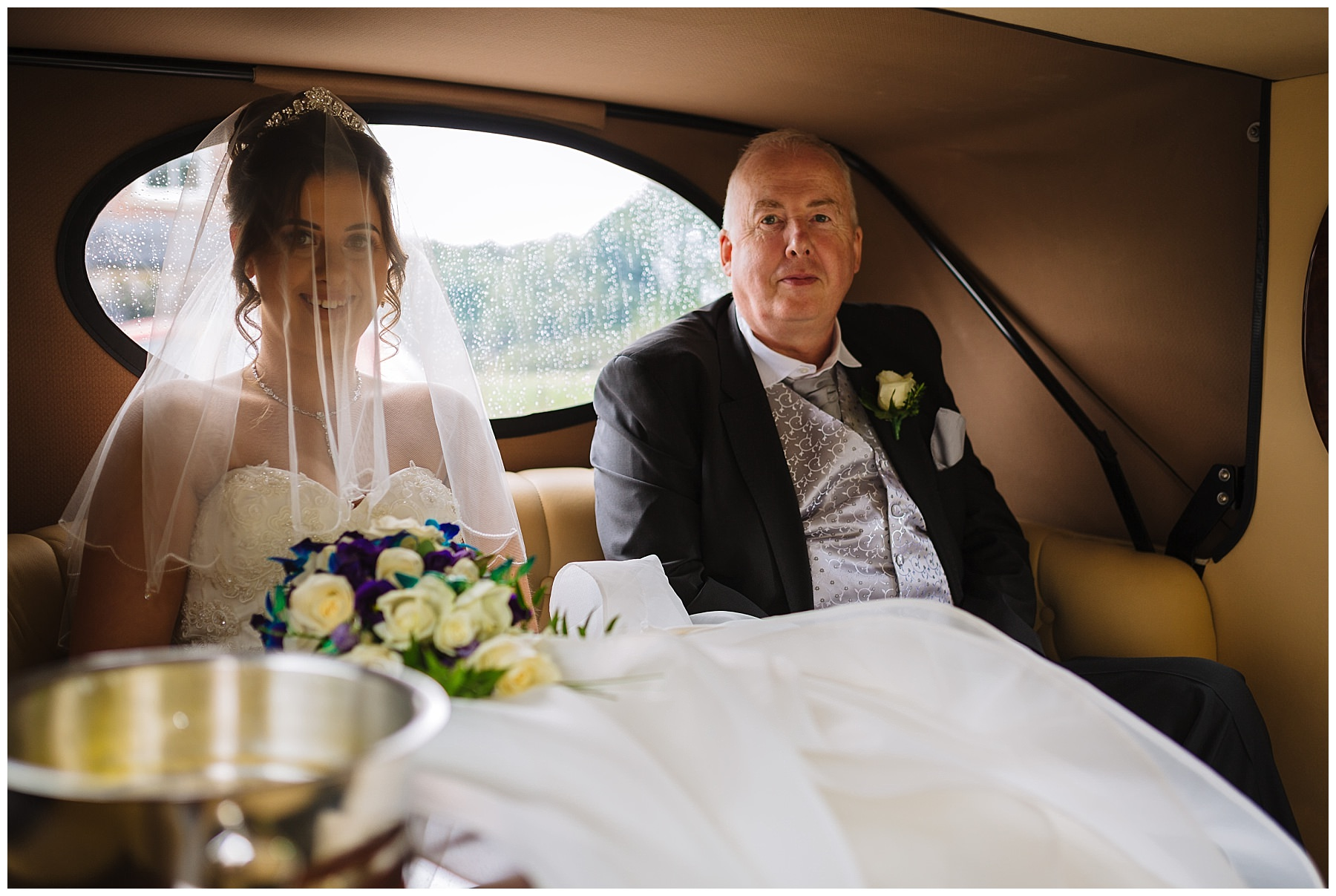 Bride and dad arrive in wedding car
