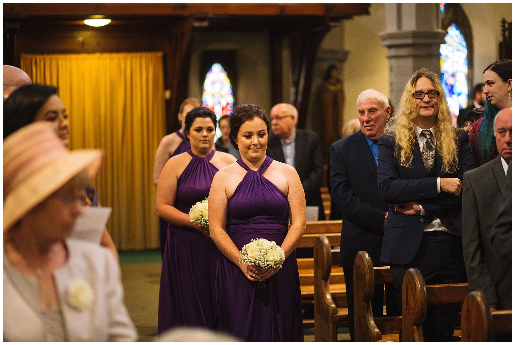 bridesmaids arrive into church for wedding ceremony