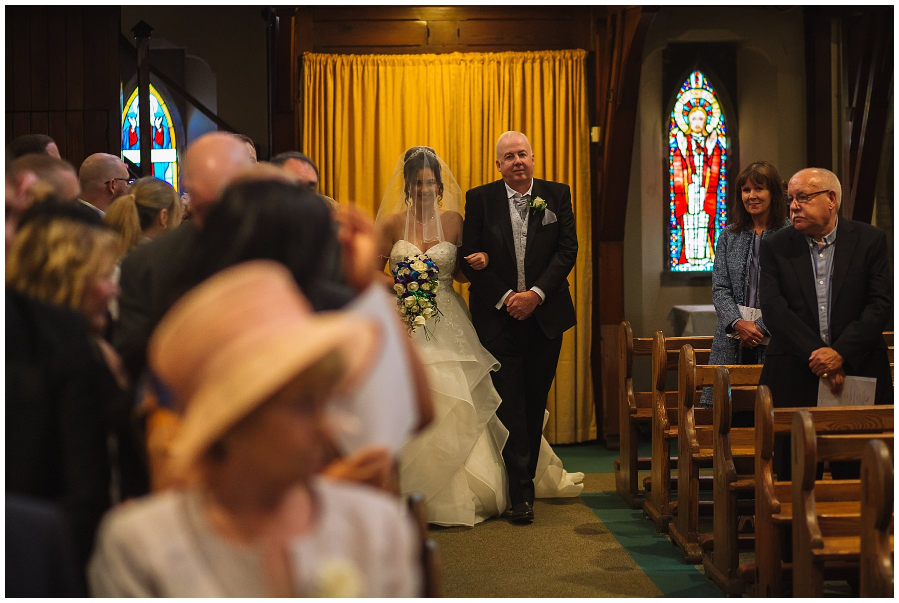 bride walked down the isle by father