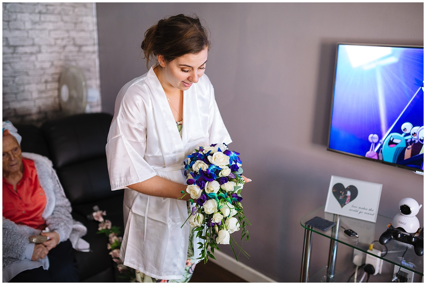 Bride admires teardrop bouquet