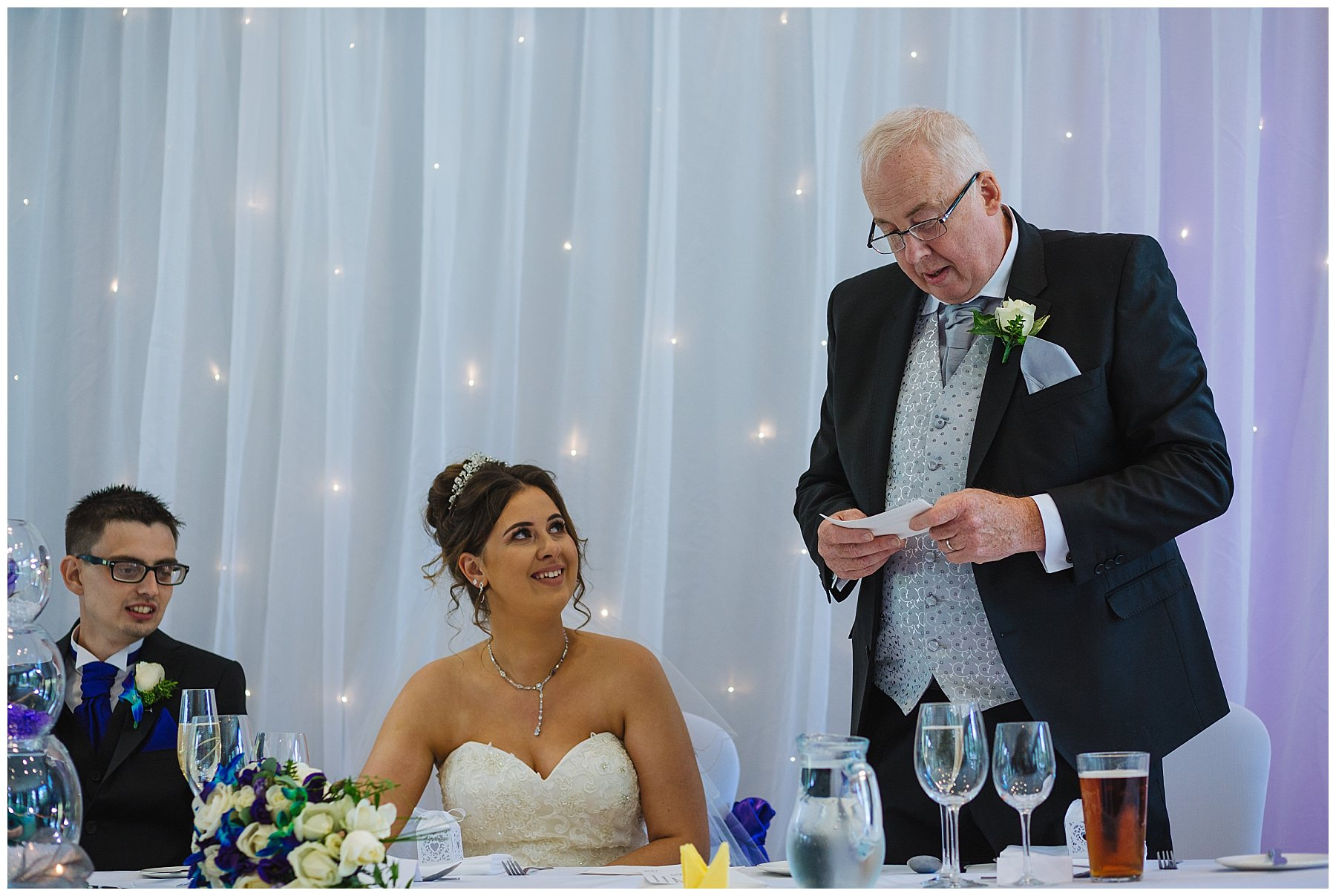 bride looks at father as he gives his speech