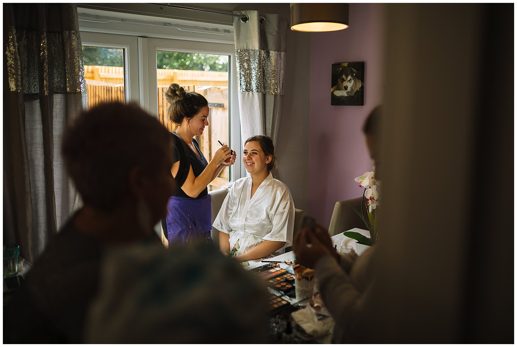 Busy bridal prep scene at brides house