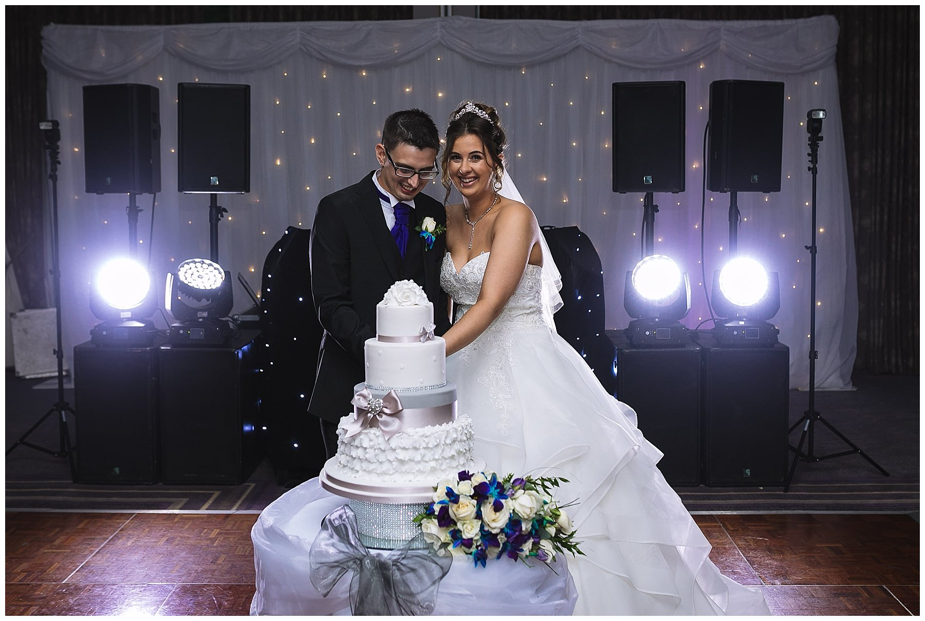 bride and groom cut wedding cake at kilhey court