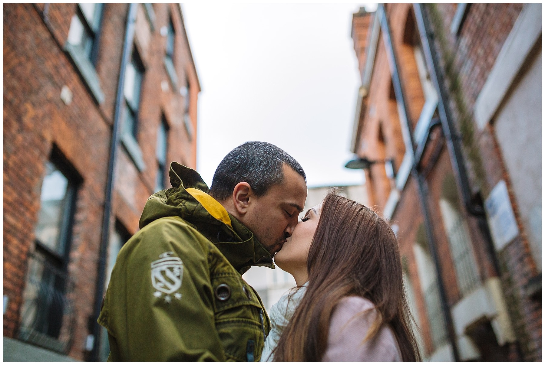 Couple kiss in streets of manchester