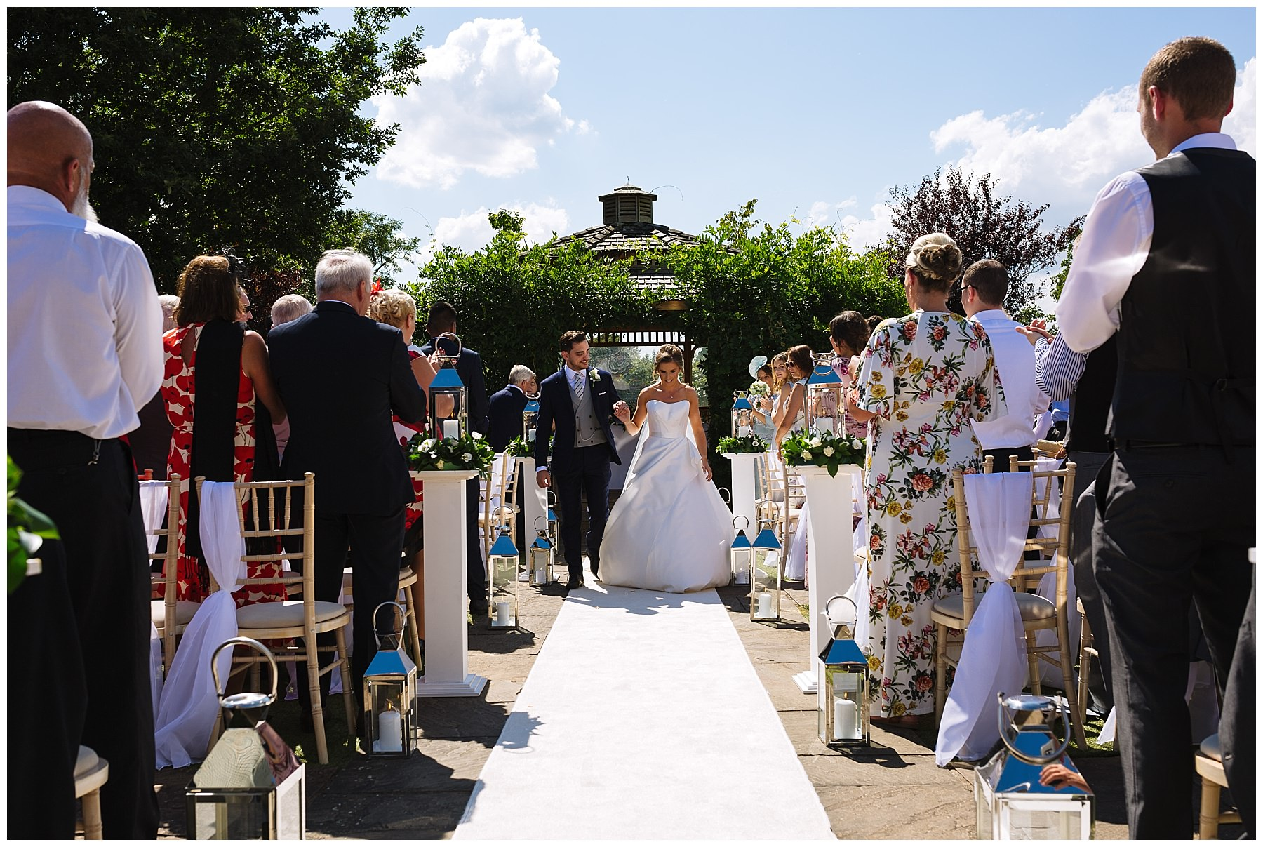 bride and groom exit outdoor wedding ceremony