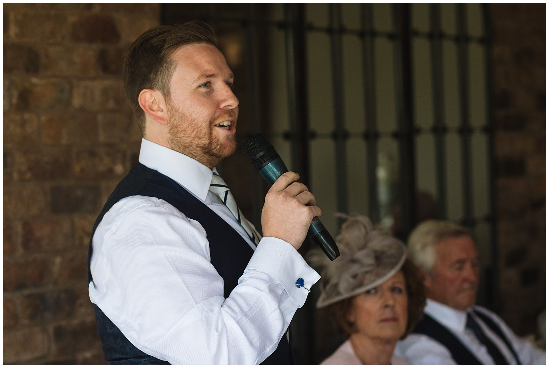Best man addresses guests during wedding breakfast