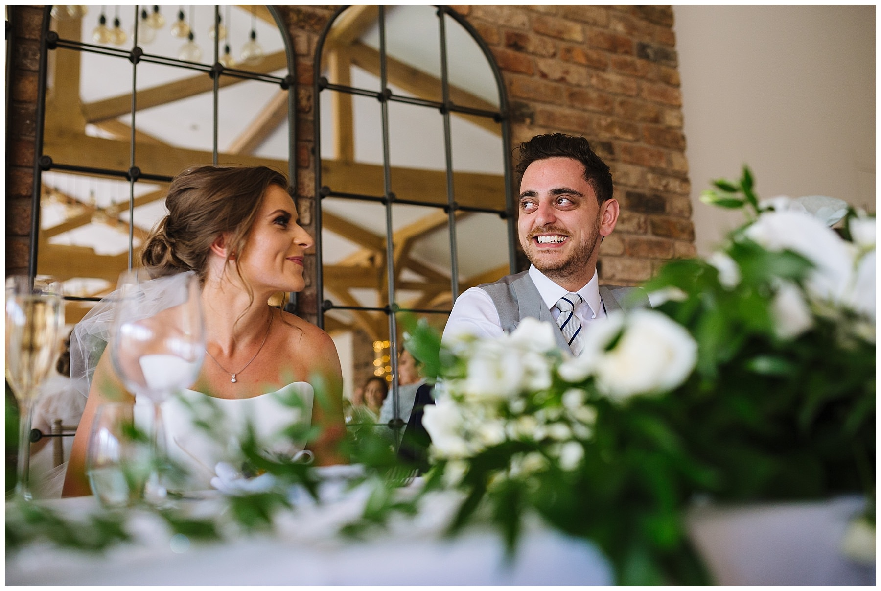 bride and groom react to best mans speech