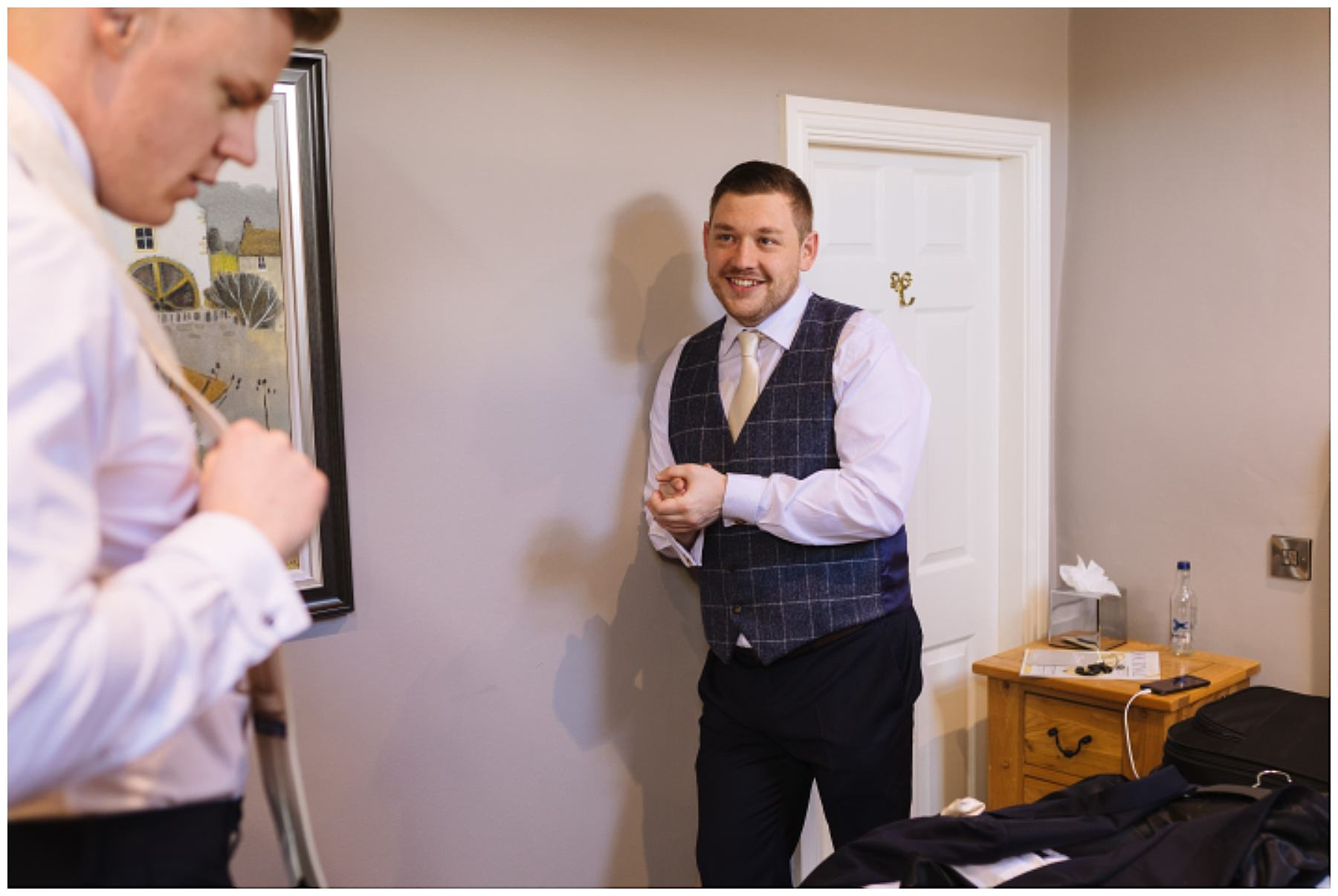 groom and groomsmen get ready for eaves hall wedding