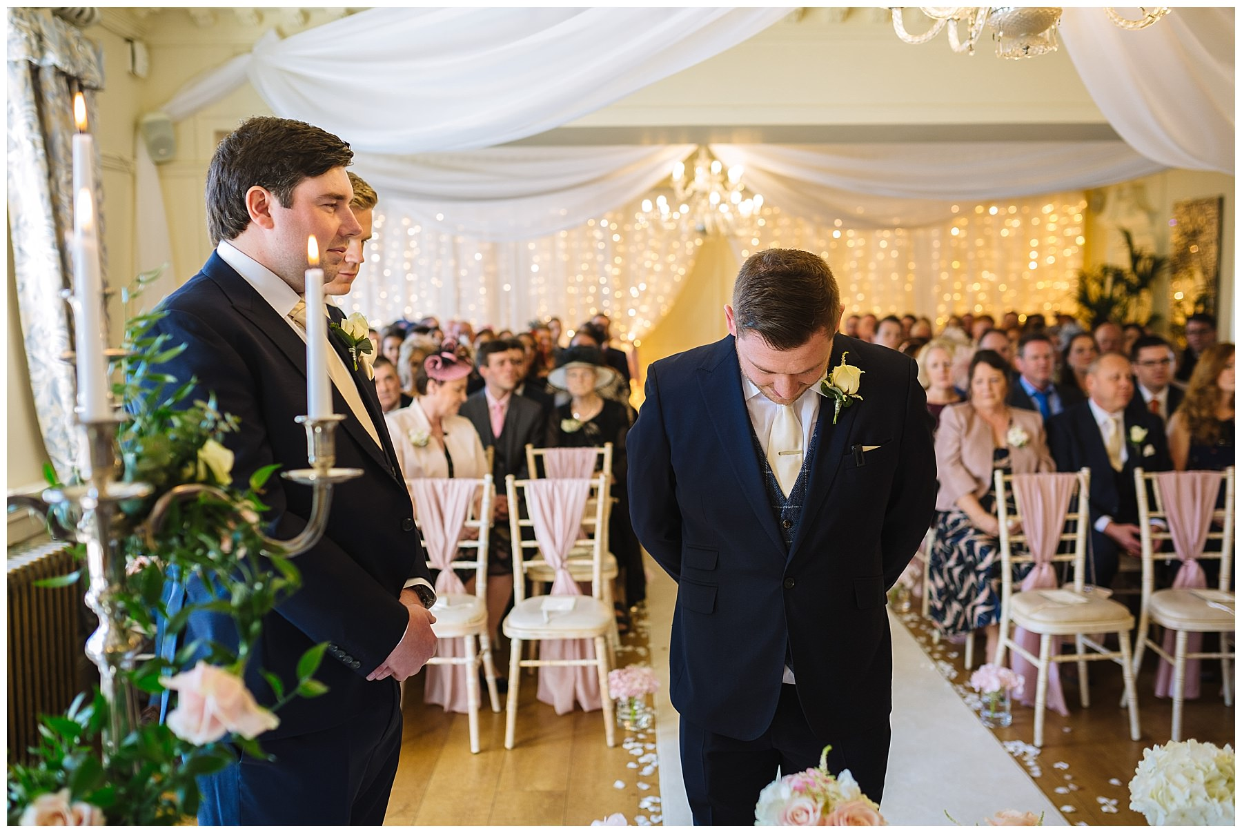 Groom waits nervously for bride in Eaves hall wedding ceremony room