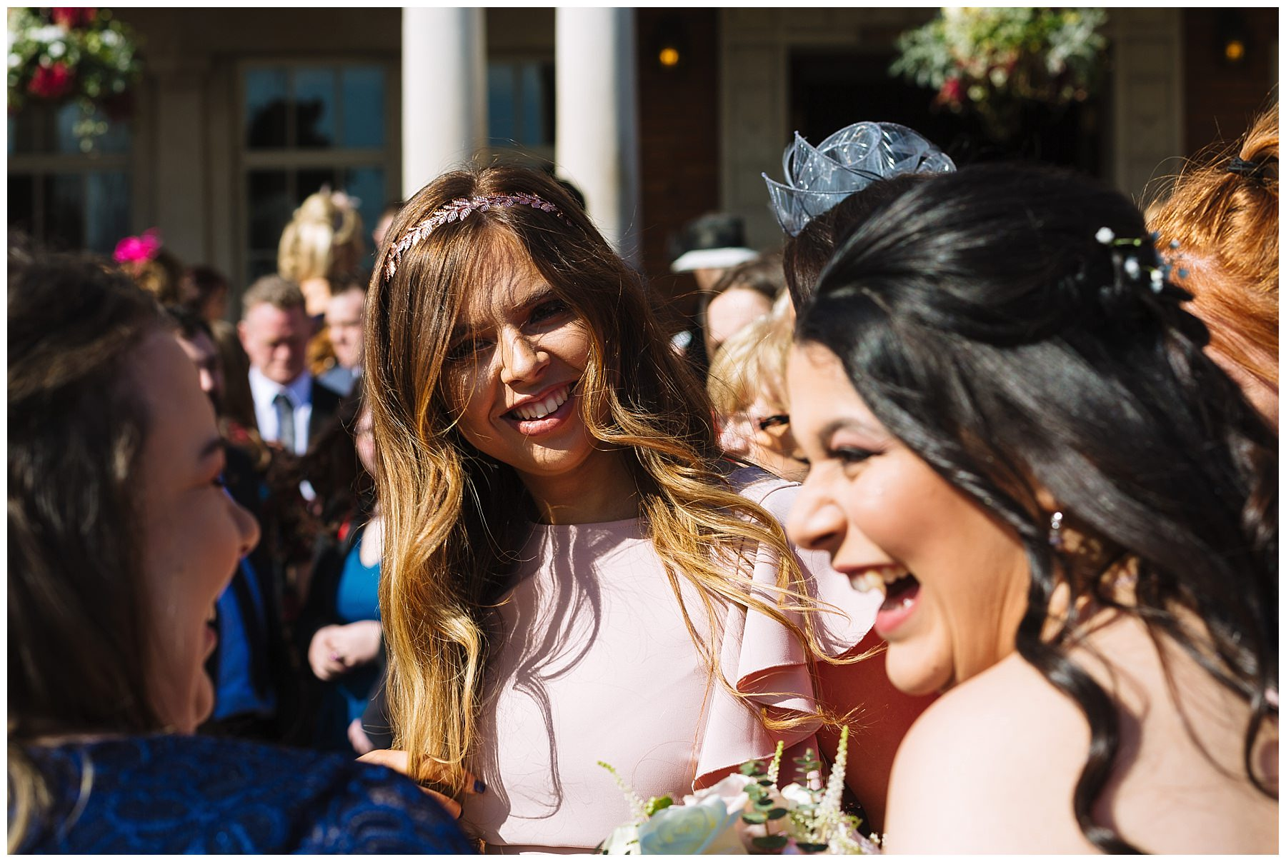 wedding guests enjoy the winter sun at eaves hall