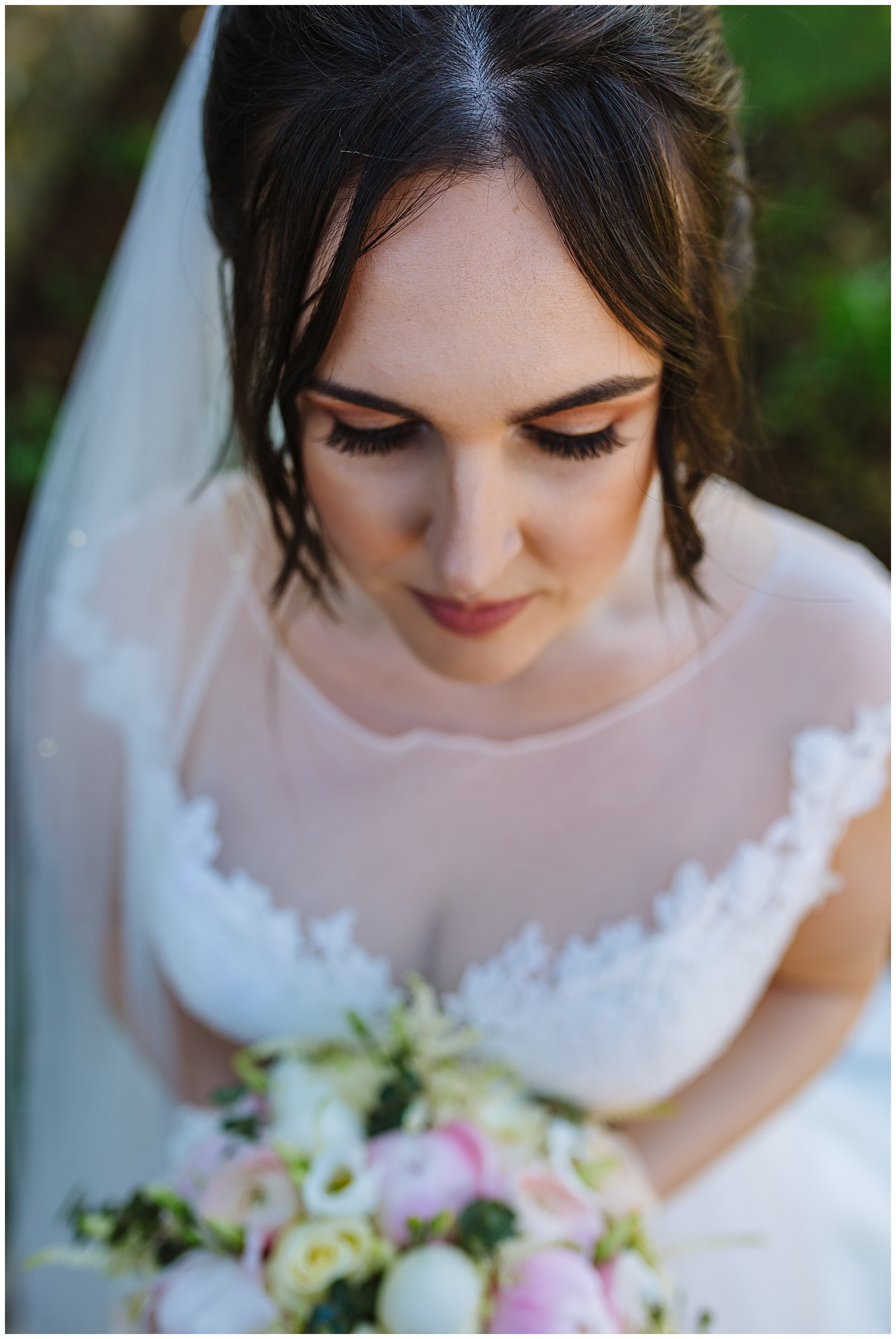 Bridal portrait showing hair and make up and flowers