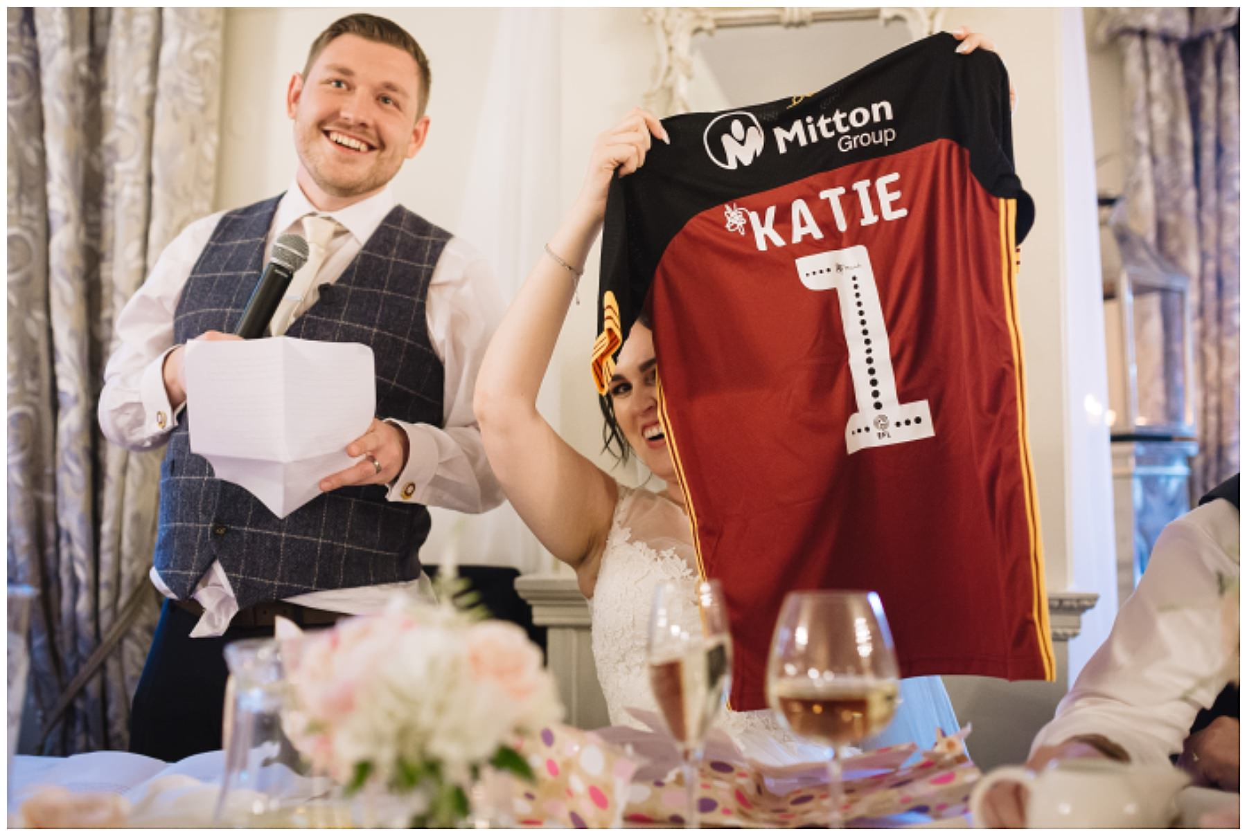 bride holds up football shirt presented as wedding gift