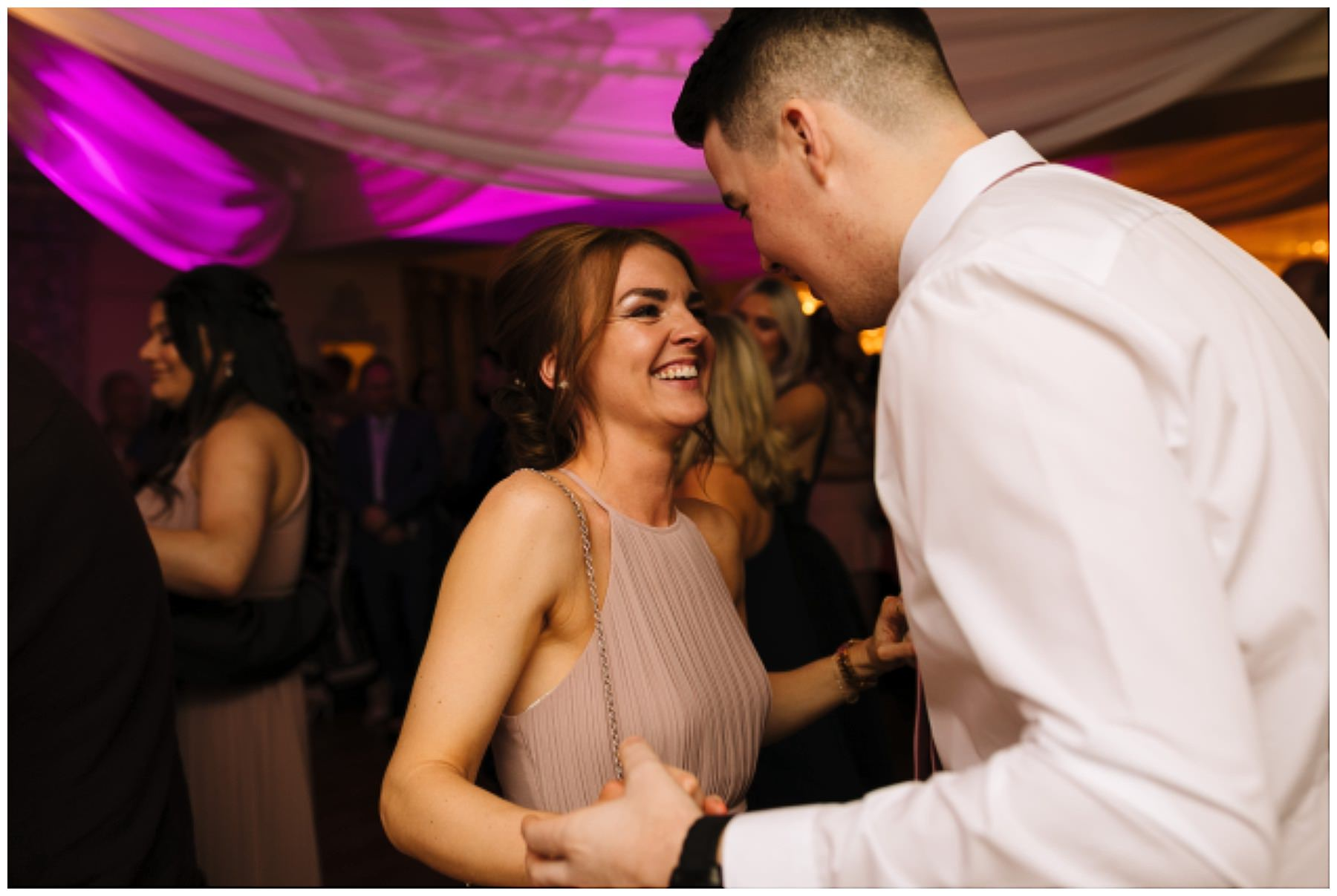wedding guests on the dance floor at eaves hall