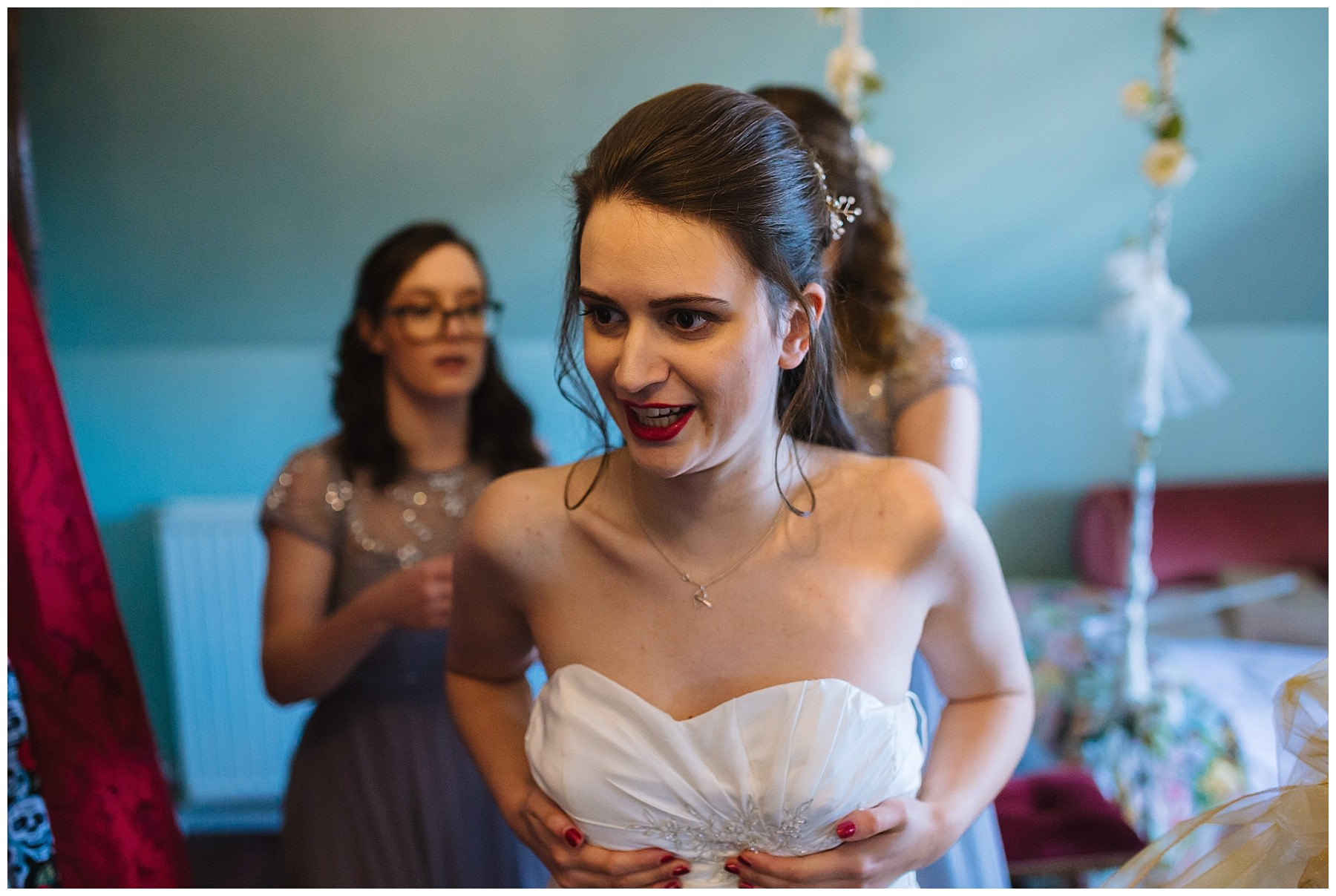 Bride puts on wedding dress at Hundred House Hotel