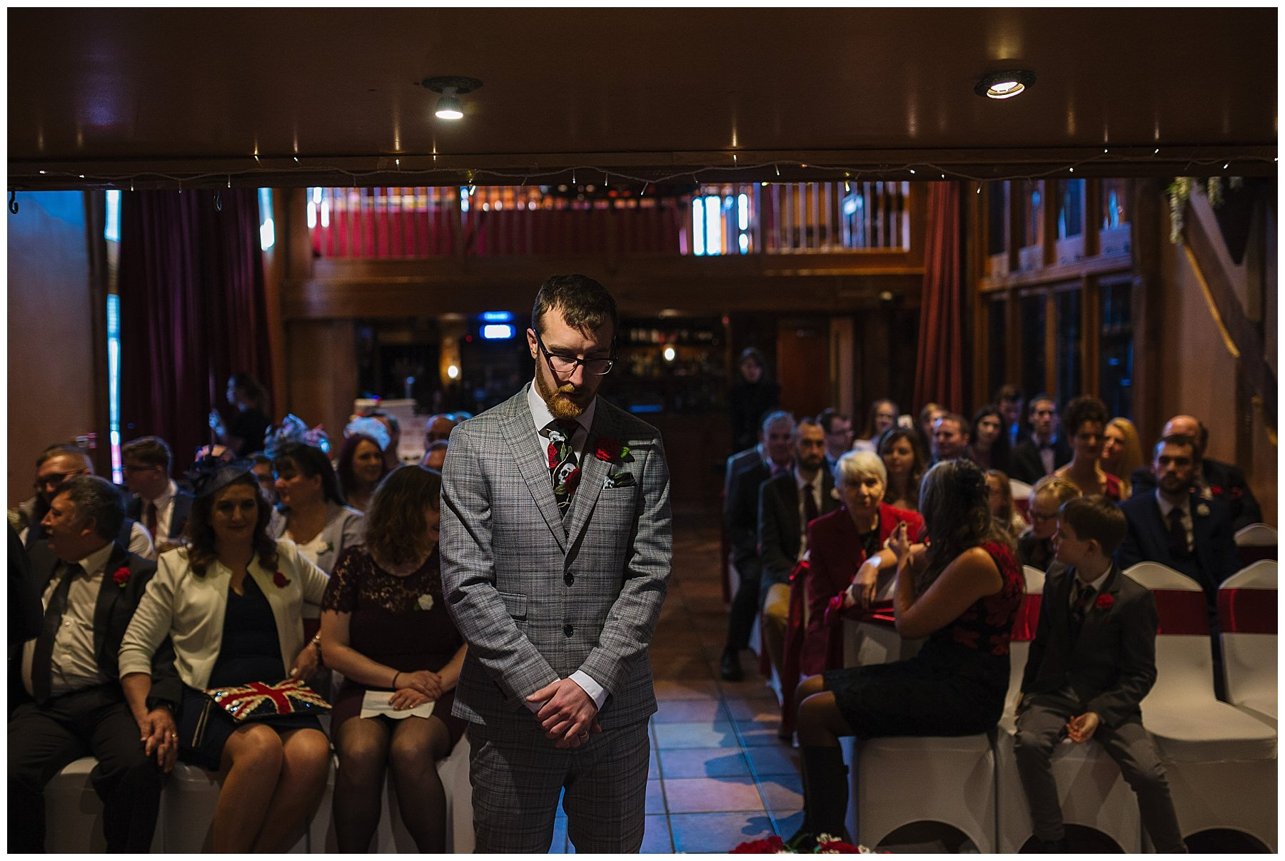 Groom waits nervously for his bride at the hundred house hotel