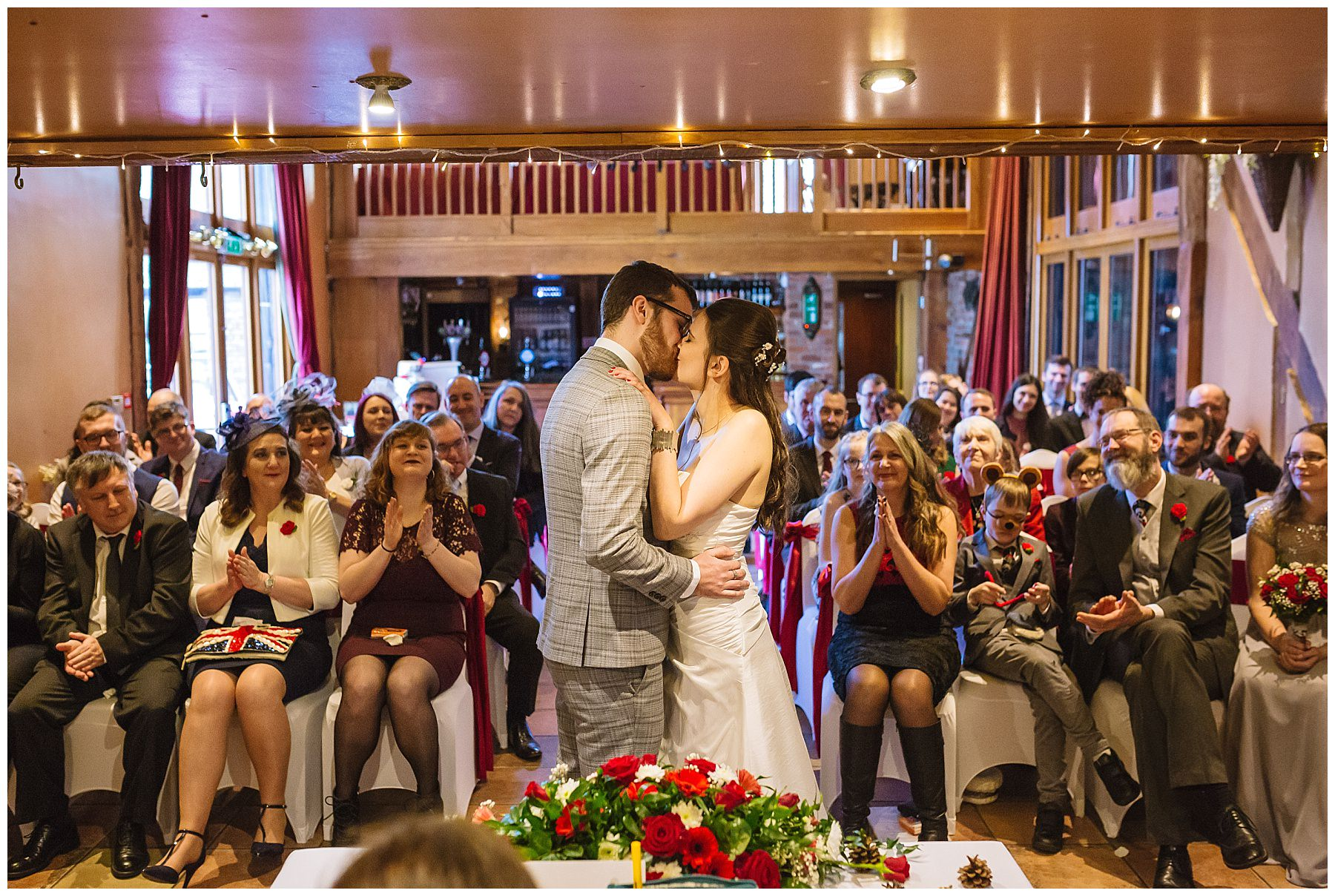 First kiss for bride and groom at hundred house hotel