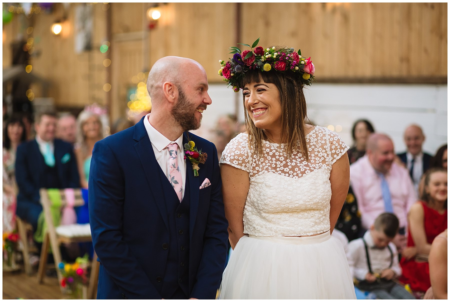 bride and groom smile at each other during quirky wedding at the wellbeing farm