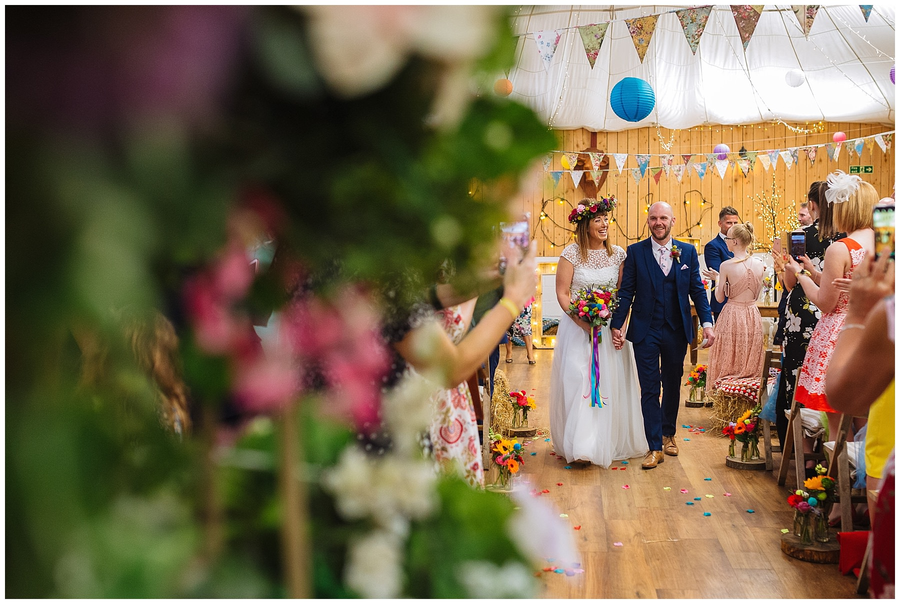 bride and groom walk down the isle as husband and wife at the wellbeing farm