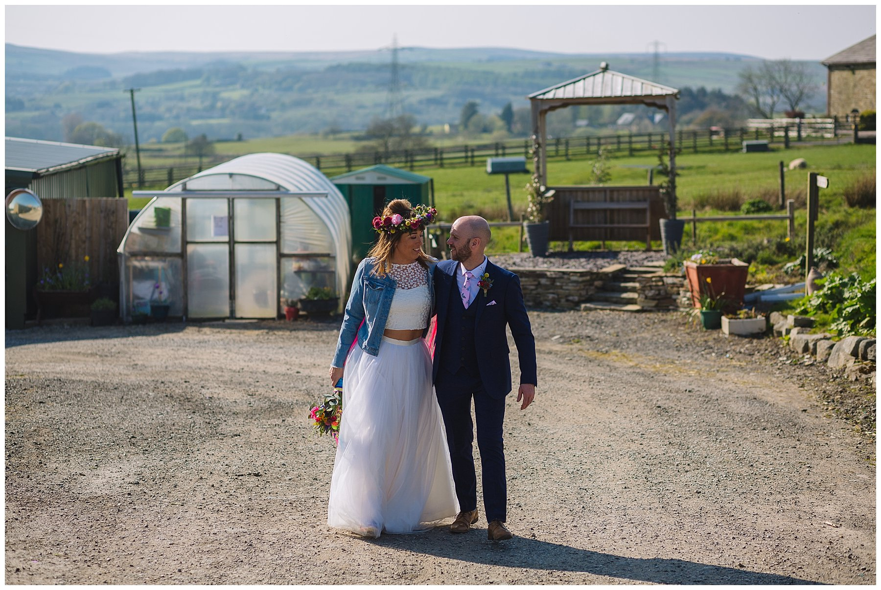 Bride and groom wander through the grounds of the wellbeing farm