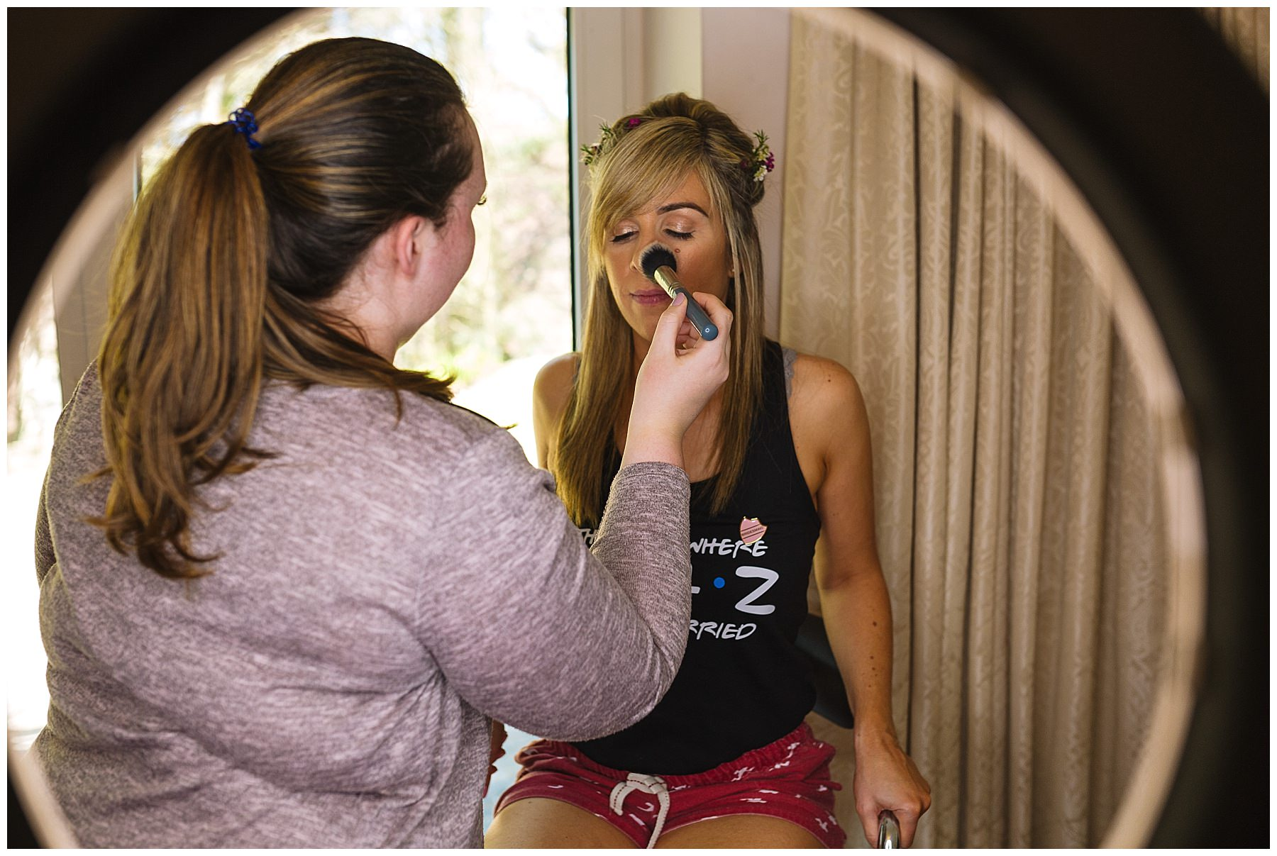 bridesmaid has make up applied