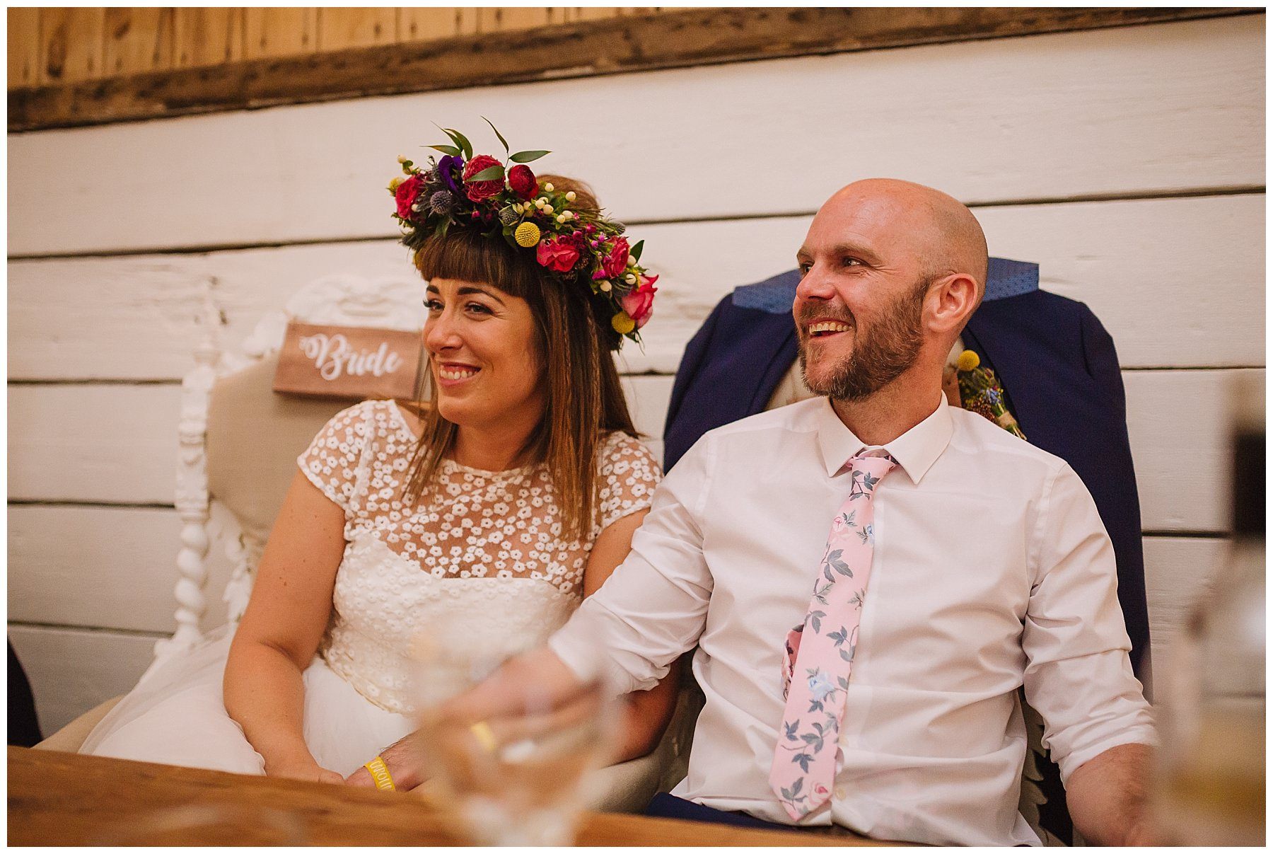 bride and groom laugh during bolton farm wedding