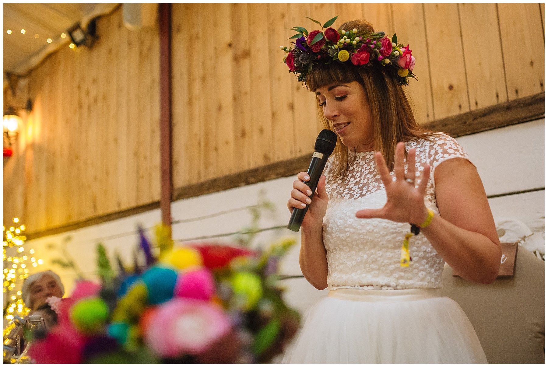 bride breaks with tradition and addresses guests at farm wedding in bolton