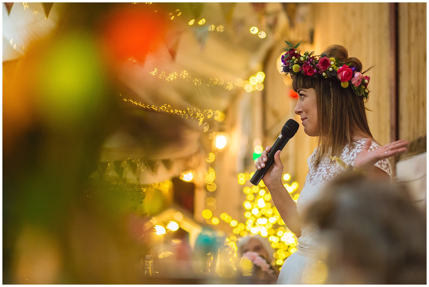 brides speech during quirky festival wedding