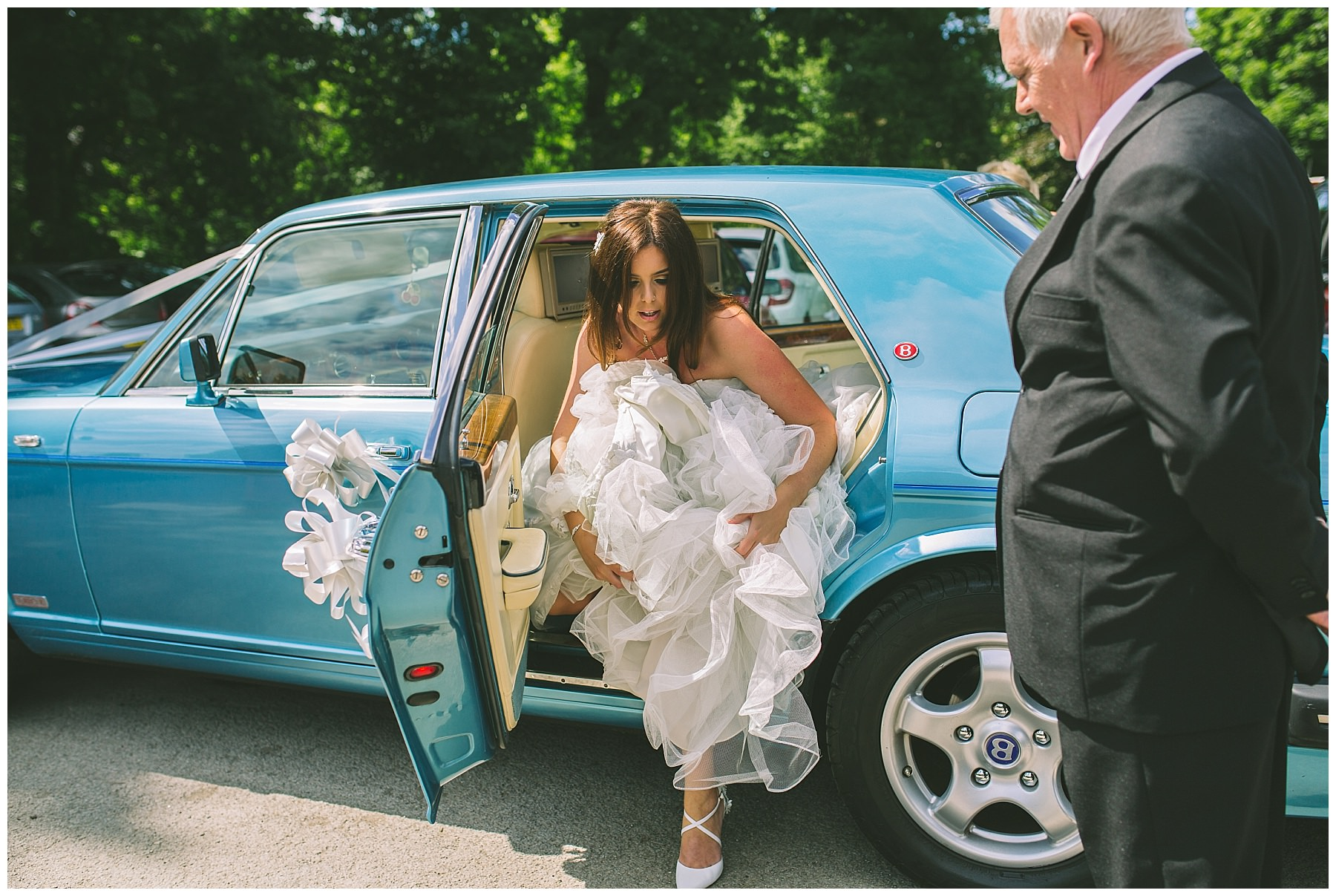 bride steps out of wedding car