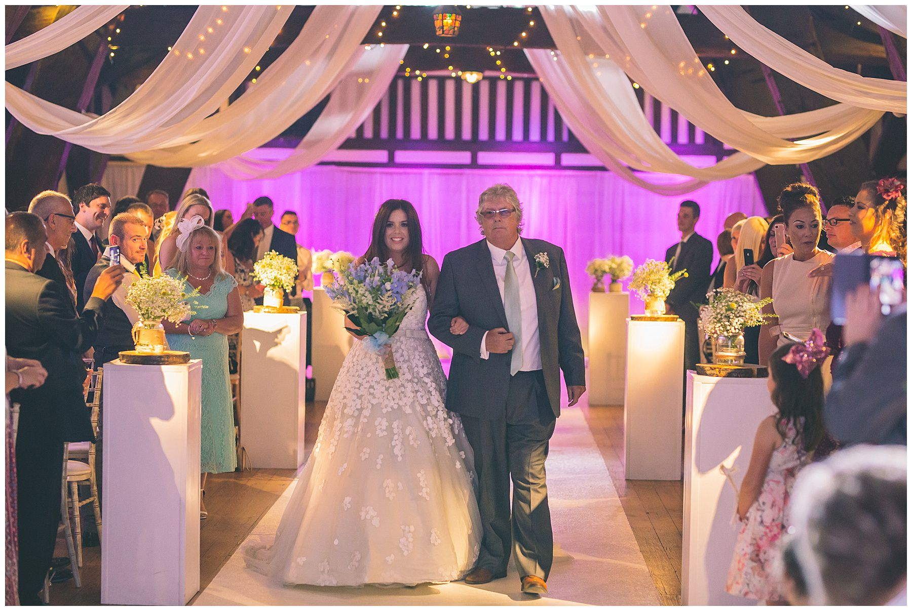 Bride walks down the isle with dad at rivington barn wedding