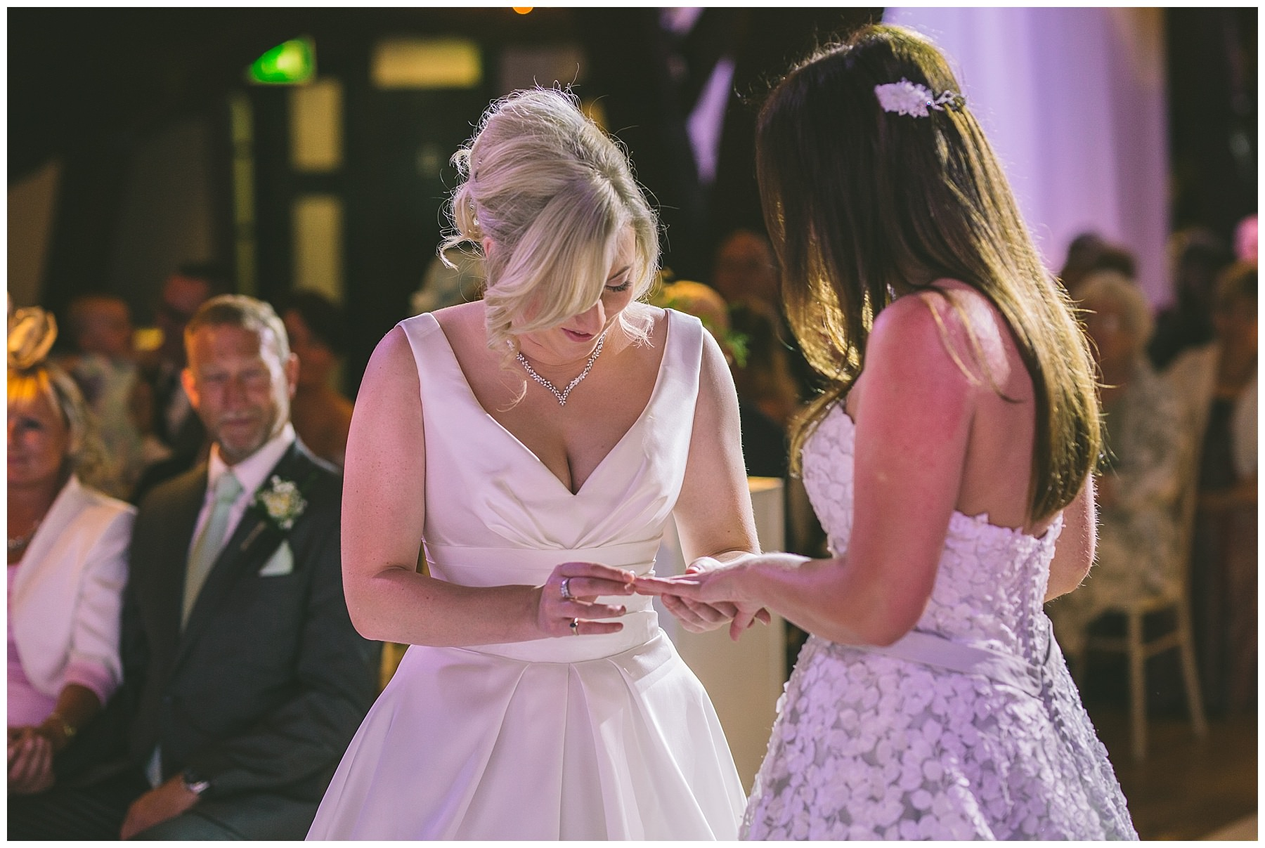 brides exchange wedding rings during Rivington Barn Wedding